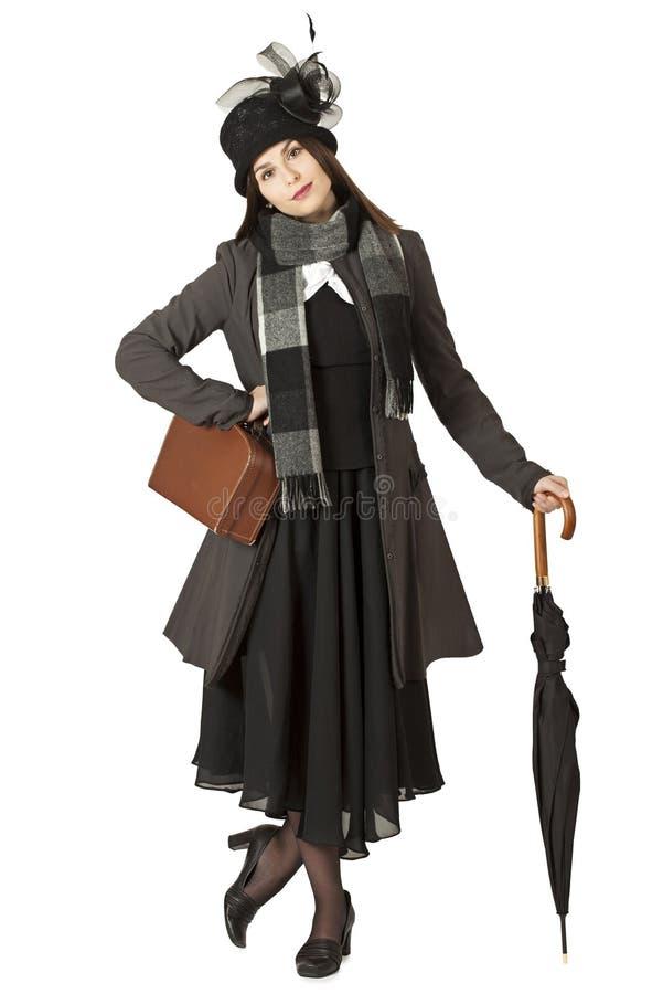 Νέα γυναίκα στο ρόλο της Mary Poppins στοκ φωτογραφίες