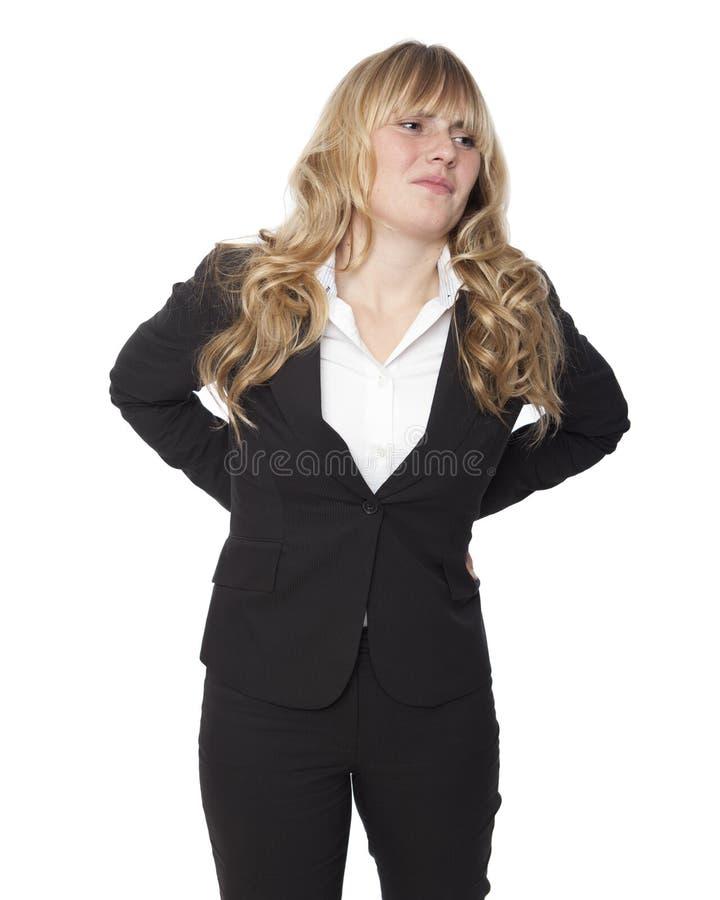 Νέα επιχειρηματίας με μια επώδυνη πλάτη στοκ φωτογραφίες με δικαίωμα ελεύθερης χρήσης