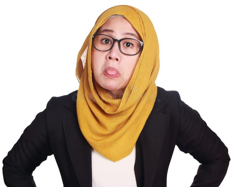 Νέα επιχειρηματίας με το χλευασμό της έκφρασης στοκ φωτογραφία