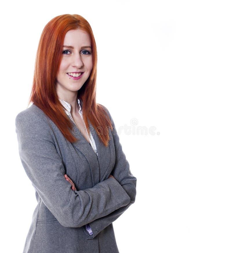 Νέα επιχειρησιακή γυναίκα με τα όπλα που διπλώνονται στοκ φωτογραφίες με δικαίωμα ελεύθερης χρήσης