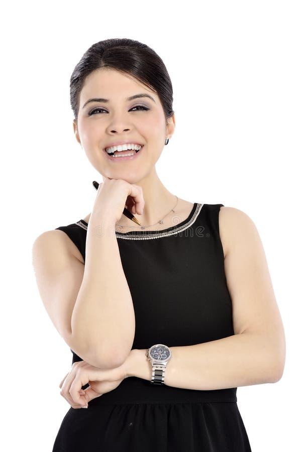 Νέα επιχειρησιακή γυναίκα που χαμογελά κρατώντας μια μάνδρα στοκ εικόνα με δικαίωμα ελεύθερης χρήσης