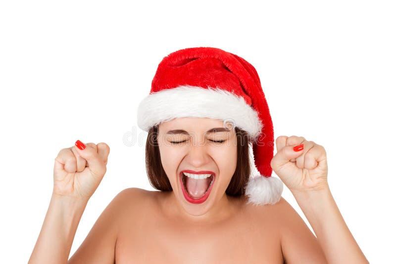 Νέα ευτυχής γυναίκα στο μαγιό και το καπέλο Χριστουγέννων συναισθηματική γυναίκα στο κόκκινο καπέλο Άγιου Βασίλη που απομονώνεται στοκ φωτογραφία με δικαίωμα ελεύθερης χρήσης