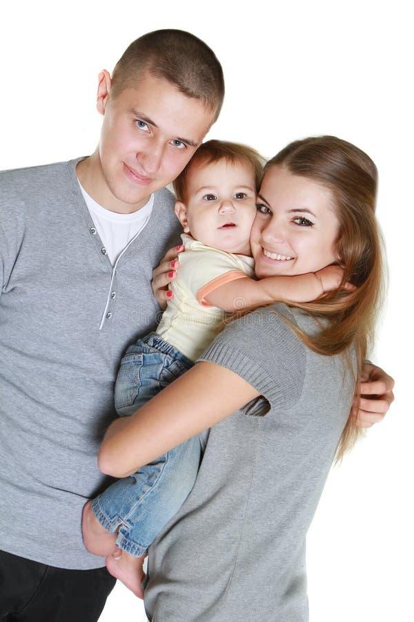 Νέα ευτυχής οικογένεια με το παιδί στοκ εικόνες