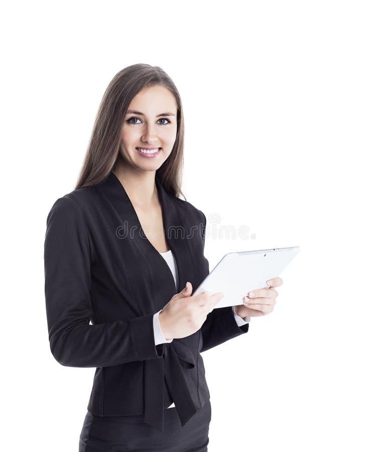 Νέα, ελκυστική, επιτυχής επιχειρησιακή κυρία, που ερευνά τη συνεργασία που χρησιμοποιεί την ταμπλέτα στοκ φωτογραφίες με δικαίωμα ελεύθερης χρήσης