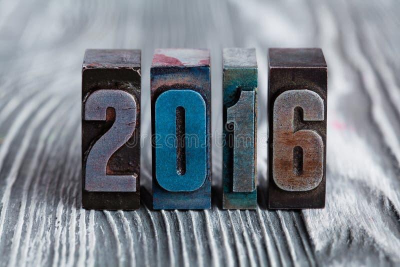 Νέα κάρτα έτους 2016 γραπτός με χρωματισμένο εκλεκτής ποιότητας letterpress στοκ εικόνα με δικαίωμα ελεύθερης χρήσης