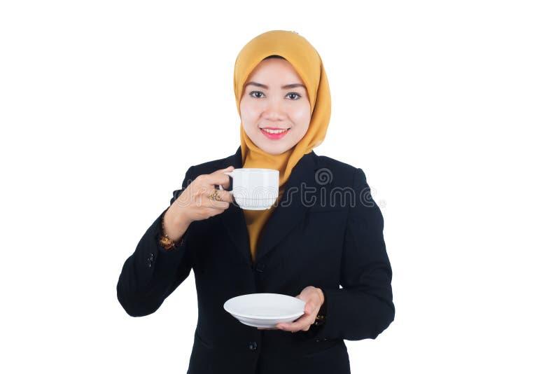Νέα και όμορφη επιχειρησιακή γυναίκα Muslimah στοκ εικόνες