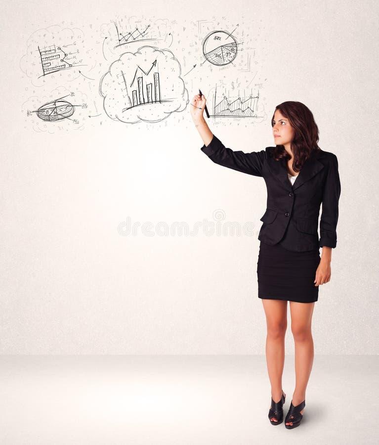 Νέα κυρία που σκιαγραφεί τα οικονομικά εικονίδια και τα σύμβολα διαγραμμάτων στοκ φωτογραφία με δικαίωμα ελεύθερης χρήσης