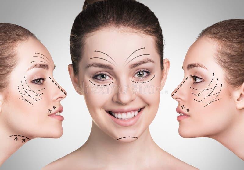 Νέα πρόσωπα γυναικών με την ανύψωση των βελών στοκ εικόνα