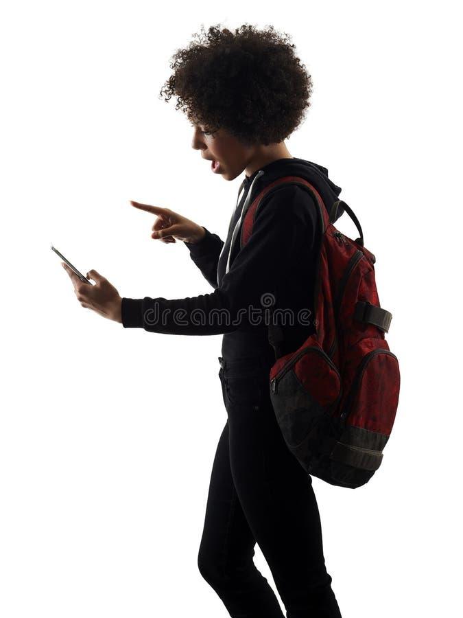 Νέα σκιαγραφία τηλεφωνικών σκιών γυναικών κοριτσιών εφήβων που απομονώνεται στοκ εικόνες με δικαίωμα ελεύθερης χρήσης