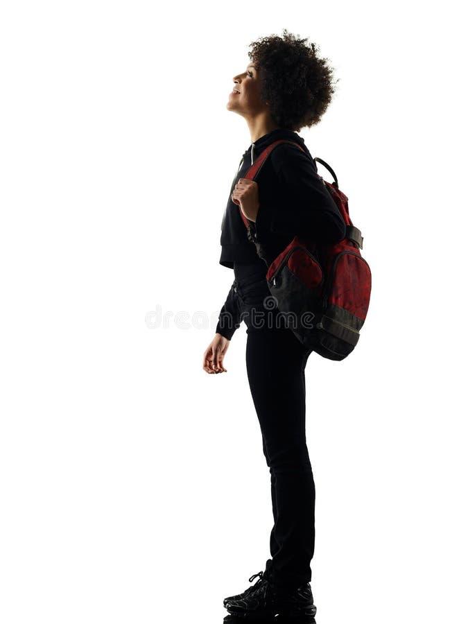 Νέα στάση γυναικών κοριτσιών εφήβων που κοιτάζει επάνω στη σκιαγραφία σκιών στοκ φωτογραφία με δικαίωμα ελεύθερης χρήσης