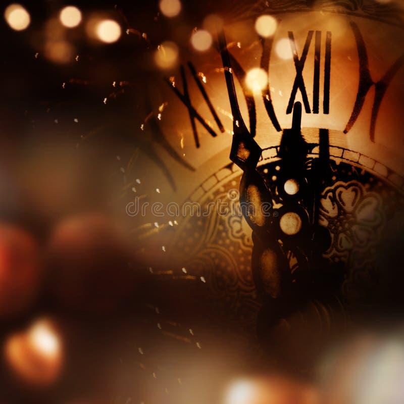 Νέα συγχαρητήρια έτους με το ρολόι στοκ εικόνες