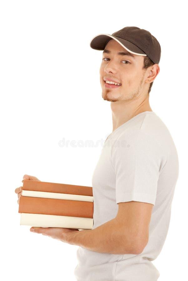 Νέα χαμογελώντας άτομα με τα βιβλία στοκ εικόνες