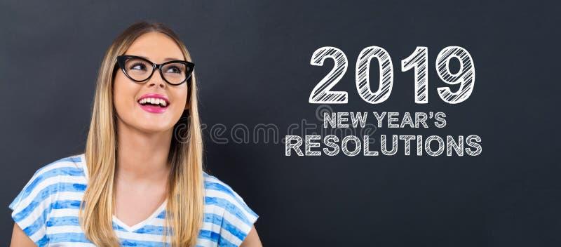 2019 νέα ψηφίσματα ετών με την ευτυχή νέα γυναίκα στοκ εικόνα