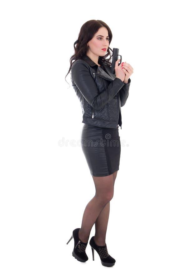 Νέα όμορφη τοποθέτηση γυναικών με το πυροβόλο όπλο που απομονώνεται στο λευκό στοκ εικόνες