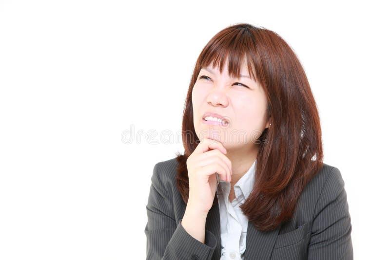 Νέες ιαπωνικές ανησυχίες επιχειρηματιών για κάτι στοκ εικόνες