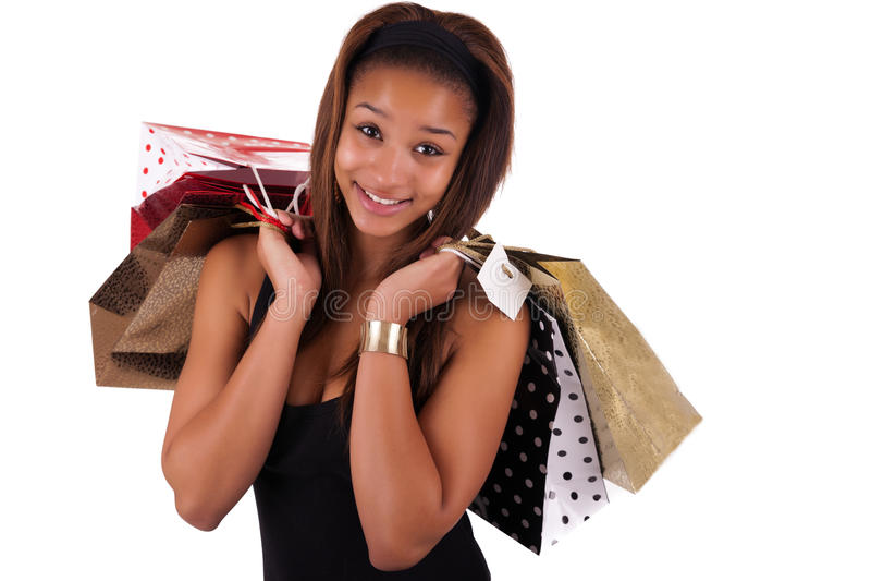 Νέος αγοραστής αφροαμερικάνων που απομονώνεται ενάντια σε ένα άσπρο backgrou στοκ εικόνα με δικαίωμα ελεύθερης χρήσης