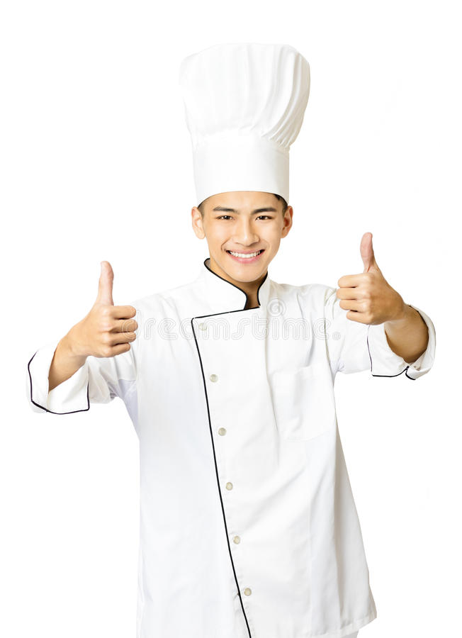 Νέος αρσενικός αρχιμάγειρας με τον αντίχειρα που απομονώνεται επάνω στο λευκό στοκ φωτογραφία με δικαίωμα ελεύθερης χρήσης