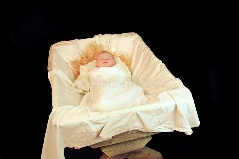 Νέος - γεννημένο μωρό Ιησούς σε μια φάτνη στοκ φωτογραφία