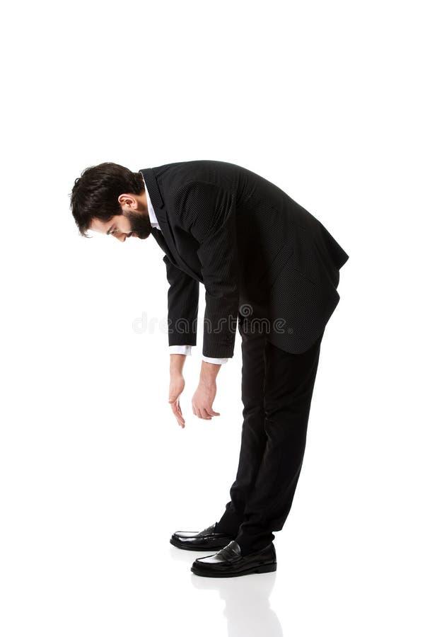 Νέος επιχειρηματίας που κάμπτει κάτω στοκ φωτογραφία με δικαίωμα ελεύθερης χρήσης