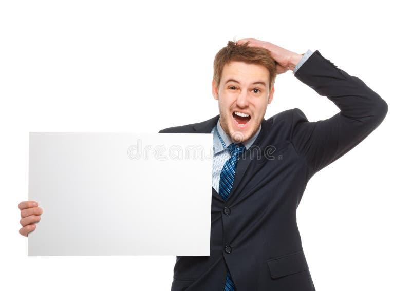 Νέος επιχειρηματίας που κρατά ένα whiteboard. Έννοια - μια κρίση ή ένα α στοκ φωτογραφία με δικαίωμα ελεύθερης χρήσης