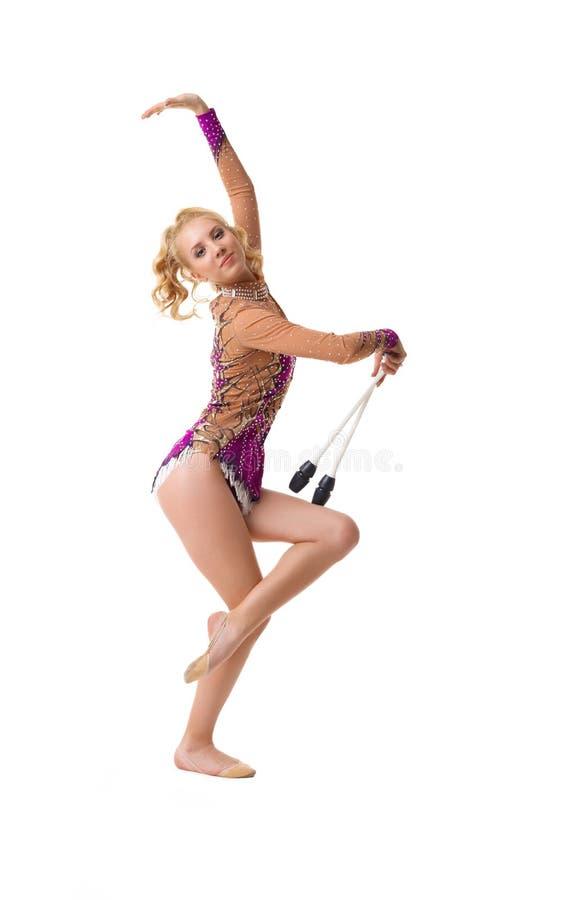 Νέος λεπτός gymnast με ένα καλλιτεχνικό πορτρέτο ράβδου στοκ εικόνες με δικαίωμα ελεύθερης χρήσης
