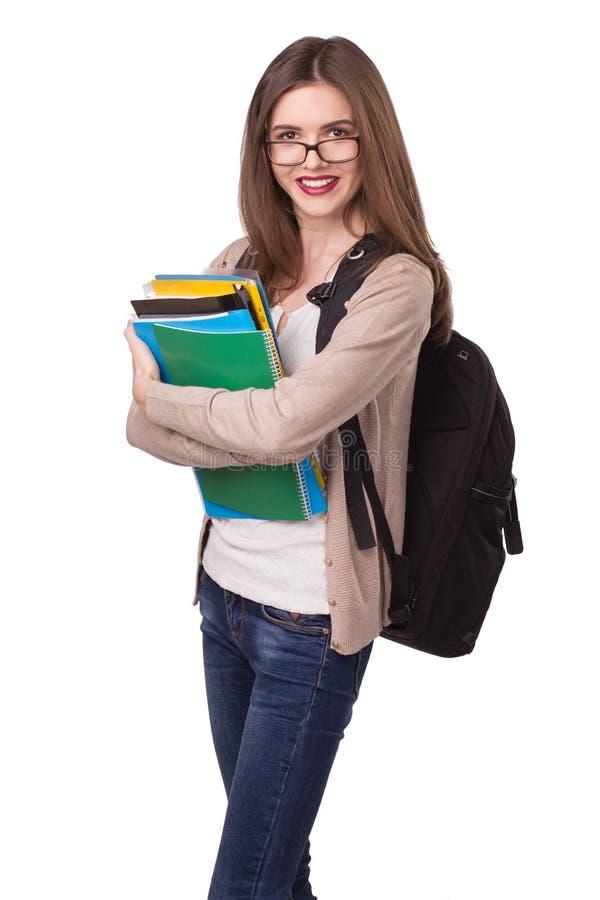 Νέος ευτυχής σπουδαστής με τα σημειωματάρια στοκ φωτογραφία με δικαίωμα ελεύθερης χρήσης