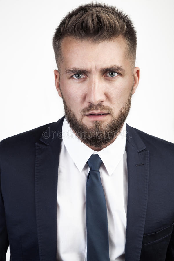 Νέος δικηγόρος με το ύποπτο βλέμμα στοκ εικόνες