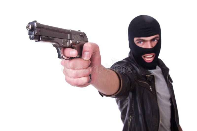 Νέος κακοποιός με το πυροβόλο όπλο στοκ εικόνα