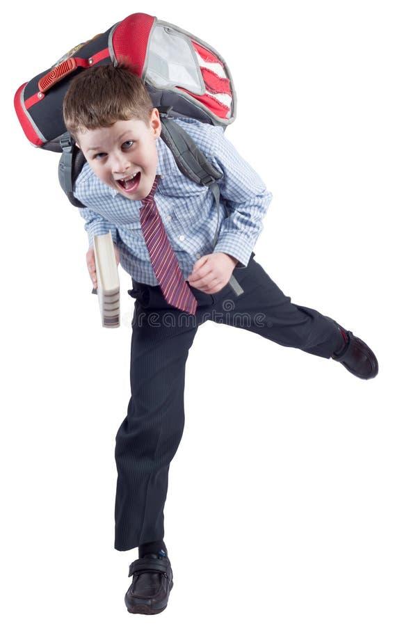 Νέος μαθητής με τη σχολική τσάντα σε μια βιασύνη στοκ φωτογραφία με δικαίωμα ελεύθερης χρήσης