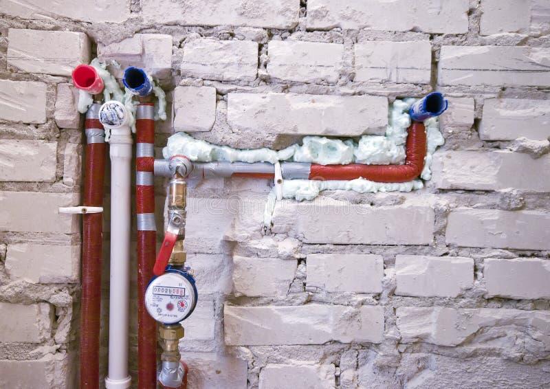 νέος τοίχος υδραυλικών εγκαταστάσεων στοκ φωτογραφίες