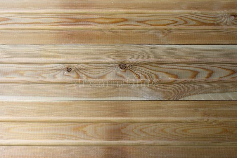 Νέος φυσικός κίτρινος ξύλινος φράκτης Φρέσκια σύσταση επιτροπών στοκ εικόνα
