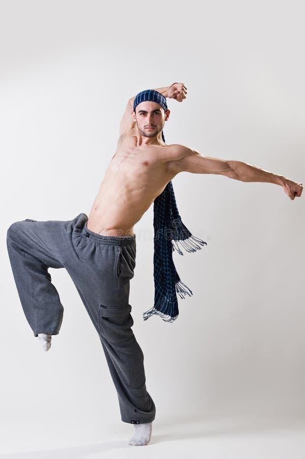 Νέος χορευτής στην κίνηση στοκ εικόνες