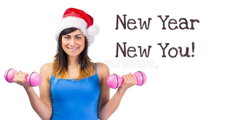 Νέο έτος νέο εσείς κείμενο και κατάλληλα βάρη ανύψωσης γυναικών στο καπέλο Santa στοκ φωτογραφία