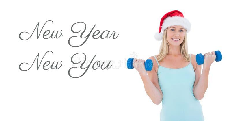 Νέο έτος νέο εσείς κείμενο και κατάλληλα βάρη ανύψωσης γυναικών στο καπέλο Santa στοκ εικόνες