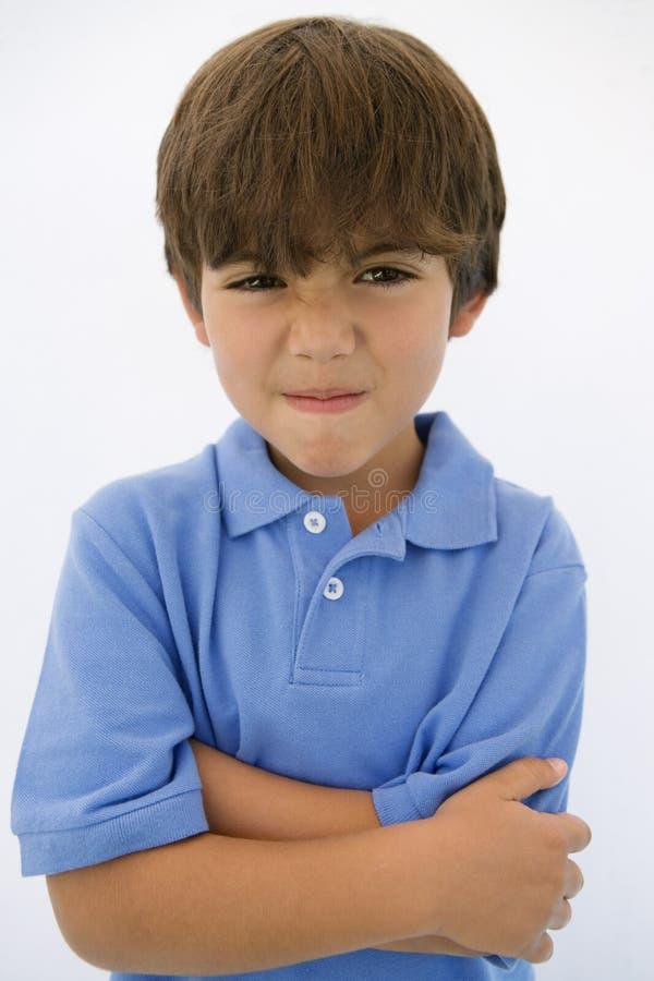Νέο αγόρι που κάνει το πρόσωπο στοκ φωτογραφία με δικαίωμα ελεύθερης χρήσης
