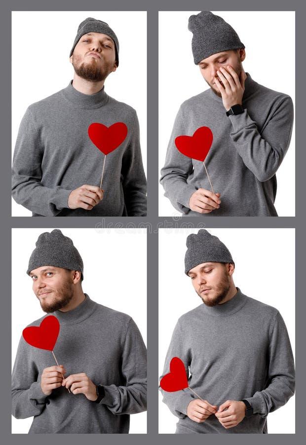Νέο ευτυχές άτομο που κρατά την κόκκινη καρδιά εγγράφου στοκ φωτογραφία με δικαίωμα ελεύθερης χρήσης