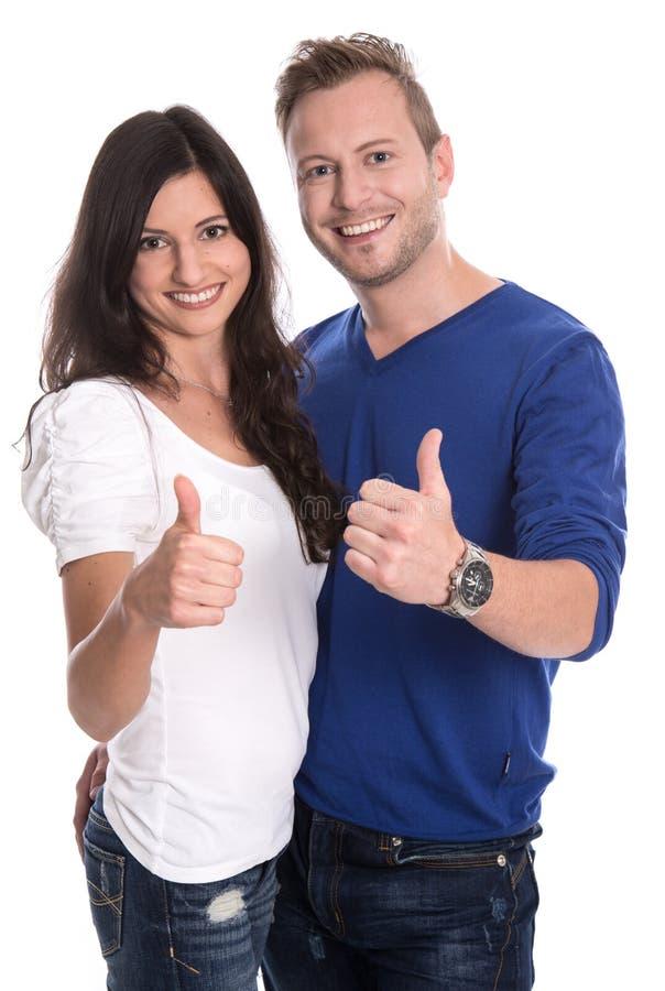 Νέο ευτυχές ζεύγος ερωτευμένο με τους αντίχειρες επάνω στοκ φωτογραφία
