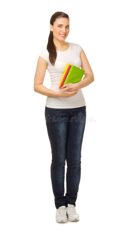 Νέο κορίτσι με τα βιβλία στοκ φωτογραφία