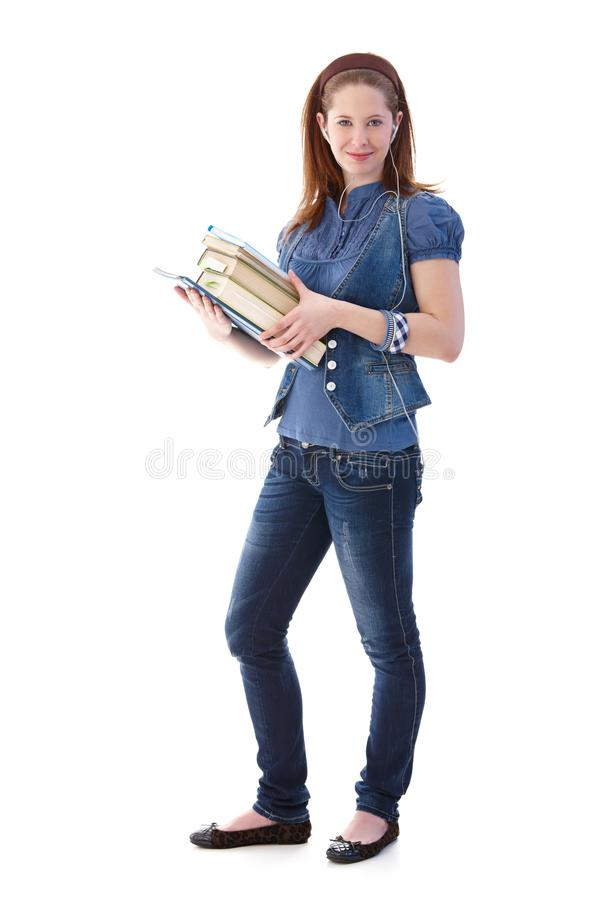 Νέο κορίτσι με το χαμόγελο βιβλίων στοκ εικόνες