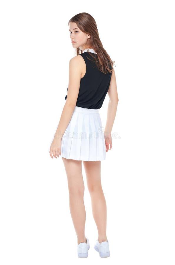 Νέο κορίτσι μόδας στην άσπρη τοποθέτηση φουστών που απομονώνεται μπακαράδων στοκ εικόνες με δικαίωμα ελεύθερης χρήσης
