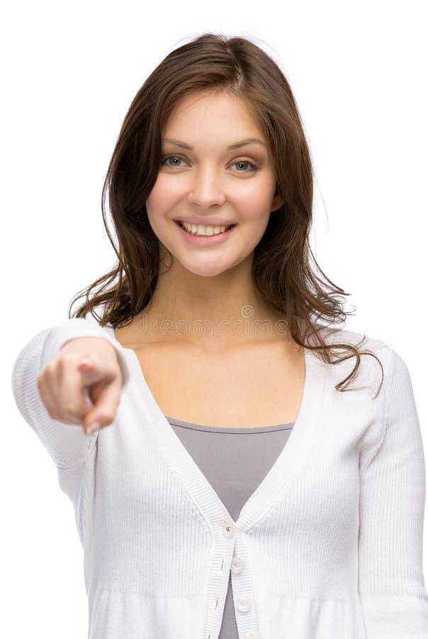 Νέο κορίτσι που δείχνει με το χέρι στοκ εικόνα