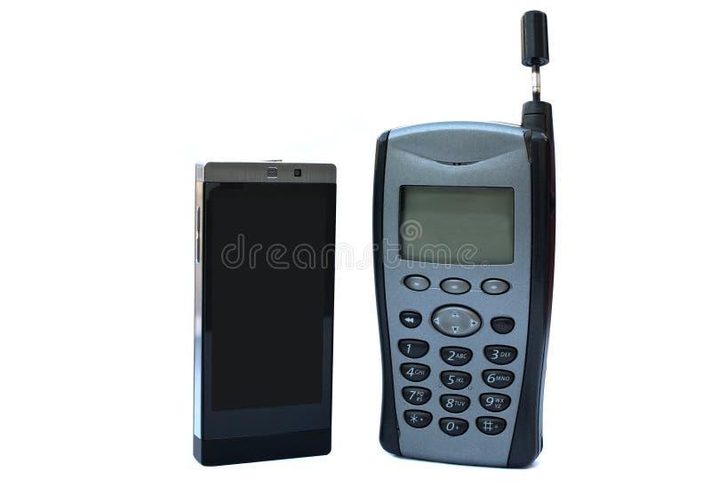 νέο παλαιό τηλέφωνο εναντί&omicr στοκ εικόνα