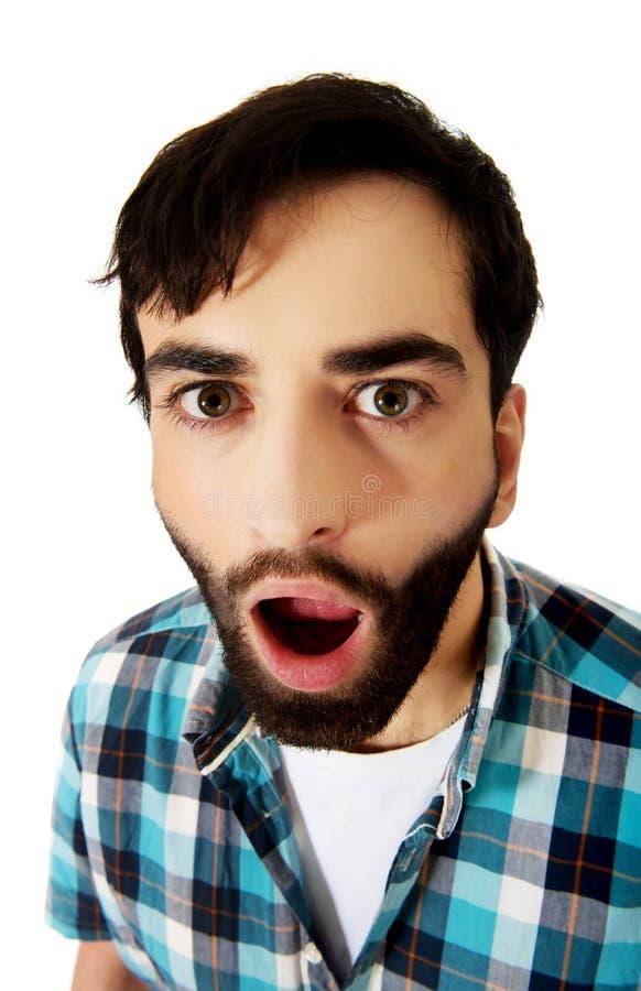 Νέο συγκλονισμένο άτομο με το στόμα ανοικτό στοκ εικόνα