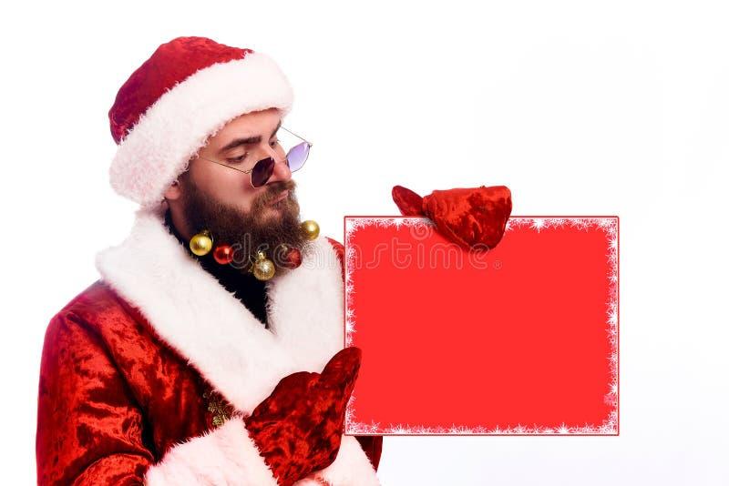 Νέο συναισθηματικό γενειοφόρο άτομο σε ένα κοστούμι Χριστουγέννων στοκ φωτογραφία με δικαίωμα ελεύθερης χρήσης