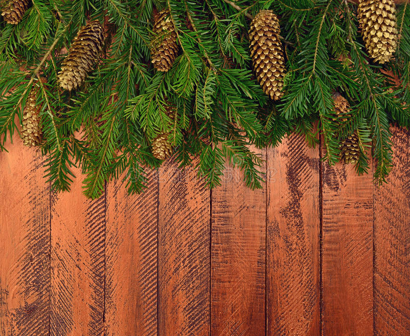 Νέο υπόβαθρο έτους σε ένα αγροτικό ύφος Κλάδοι Χριστουγέννων τ στοκ εικόνα με δικαίωμα ελεύθερης χρήσης