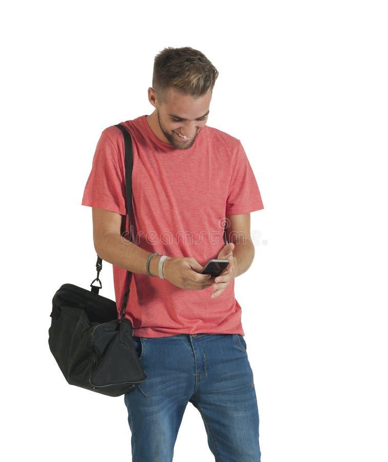Νέο όμορφο μήνυμα ανάγνωσης τύπων από το κινητό τηλέφωνό του στοκ εικόνες με δικαίωμα ελεύθερης χρήσης