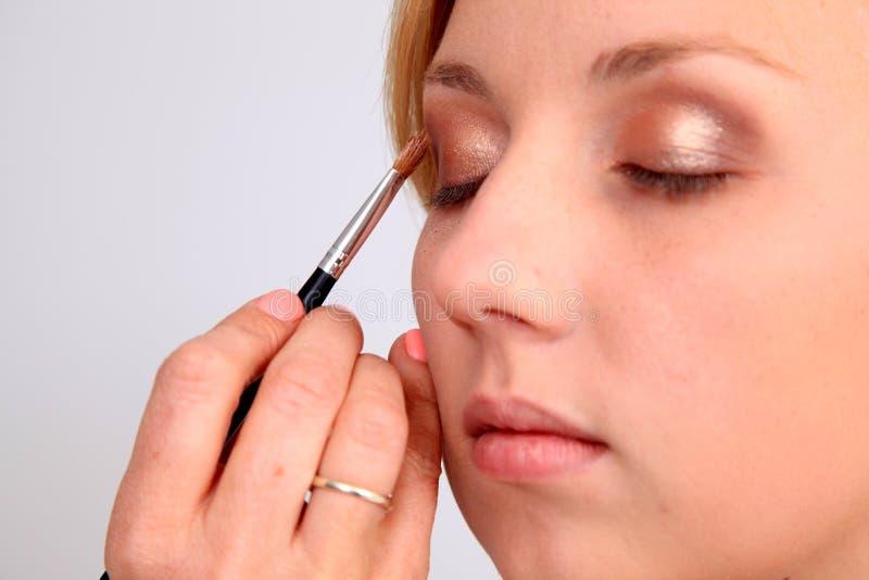 να ισχύσει makeup στοκ φωτογραφία