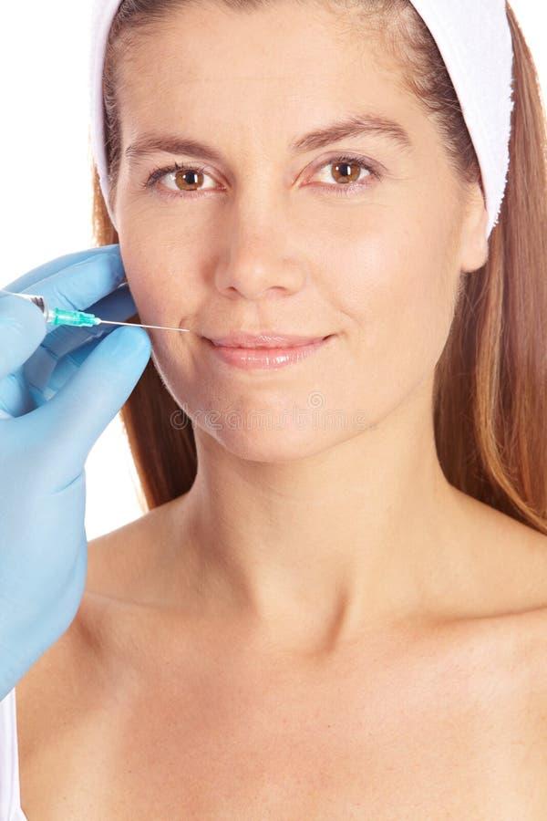 να πάρει τη γυναίκα πλαστικής χειρουργικής στοκ εικόνα