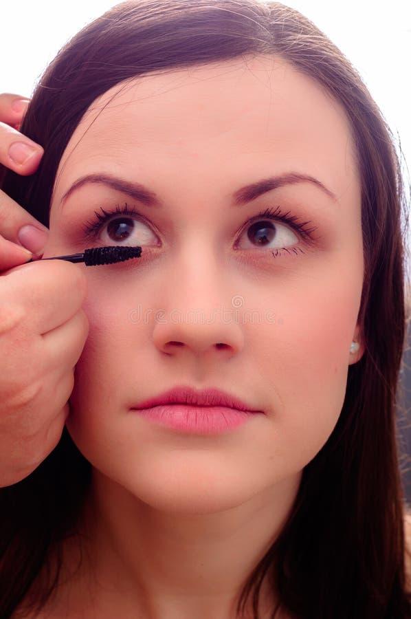 να πάρει το κορίτσι makeup στοκ εικόνα
