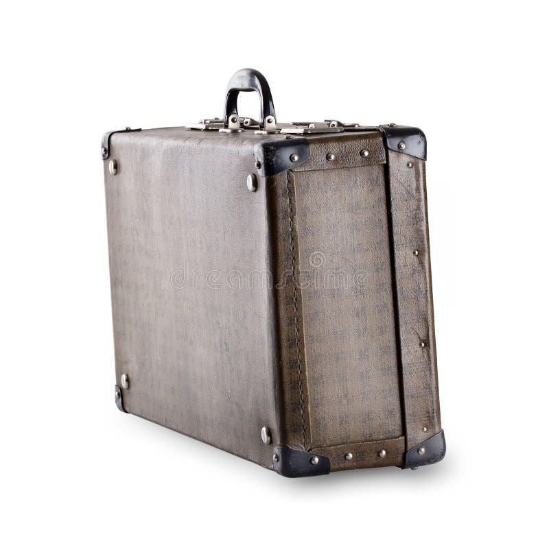 Να σταθεί διαγωνίως την ελεγμένη παλαιά βαλίτσα στοκ εικόνα